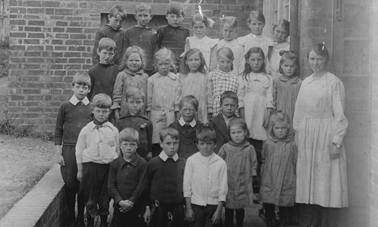 children outside old village school