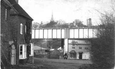 View from Old Road - railway bridge and The Ship Inn